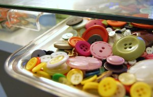 A handful of my button stash stored in a tray.